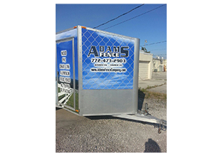 Full trailer wrap front view designed by Custom Graphics and Signs