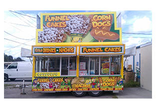 Food trailer wrap designed by Custom Graphics and Signs