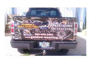 Tailgate view of truck wrap designed by Custom Graphics and Signs