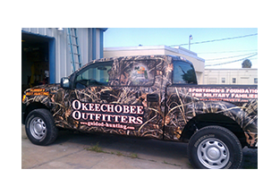 Full pickup truck wrap by Custom Graphics and Signs