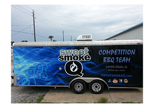 Full trailer wrap wrap  designed by Custom Graphics and Signs